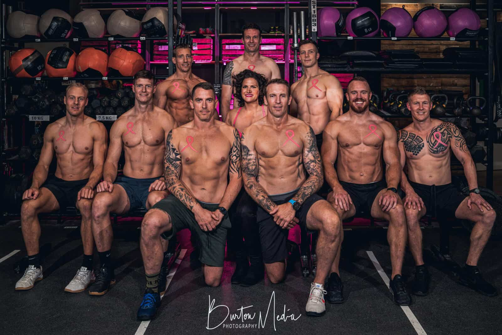 Ten topless body builders posing for the Crushing Cancer Calendar