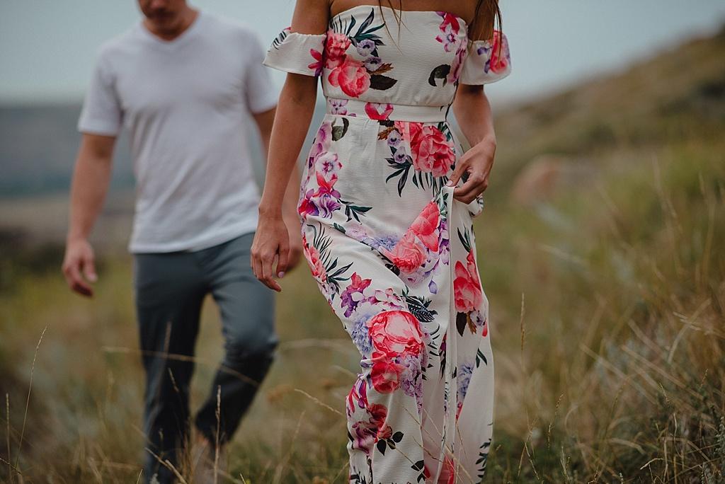 couple-walking-through-fields-Drumheller