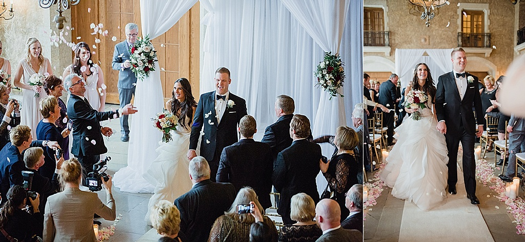 bride and groom walk down the isle to falling roses in Banff