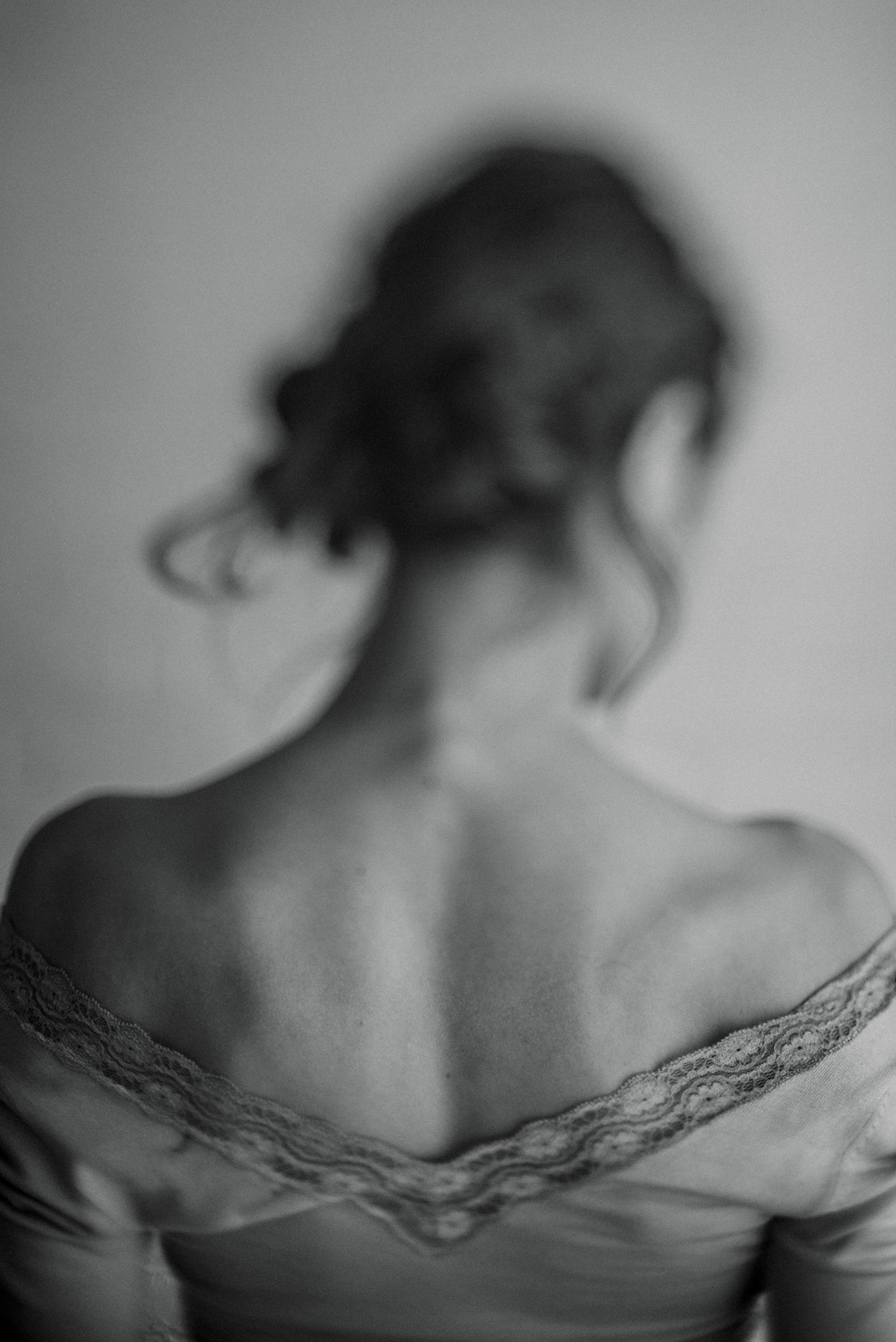 black-and-white-image-model-bare-back-hair-up