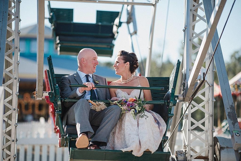 bride-groom-riding-ferris-wheel-after-wedding-ceremony
