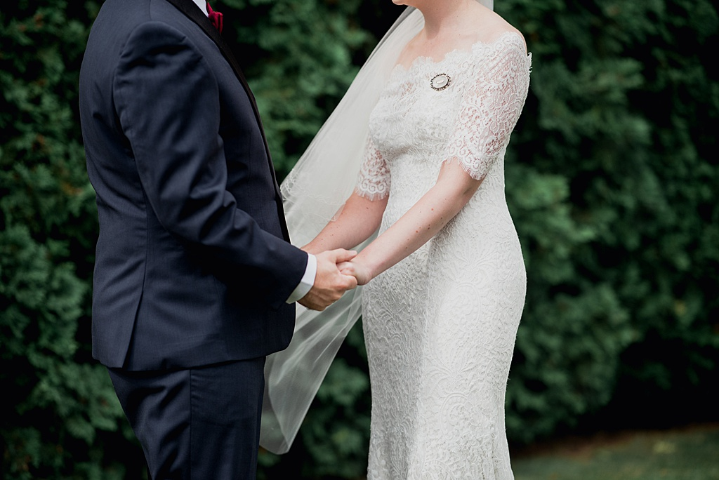 bride-groom-tightly-holding-hands