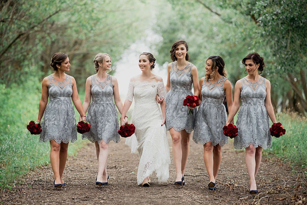 bridal-party-walking-down-path-through-forest