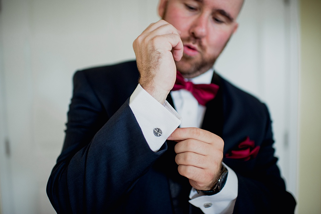 groom-doing-up-cufflinks-on-sleeve