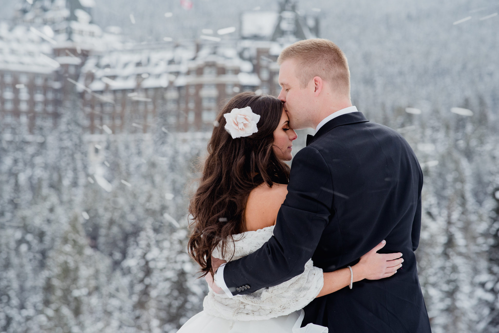 Winter Wedding at the Fairmont Banff Spring couple kissing in the snow