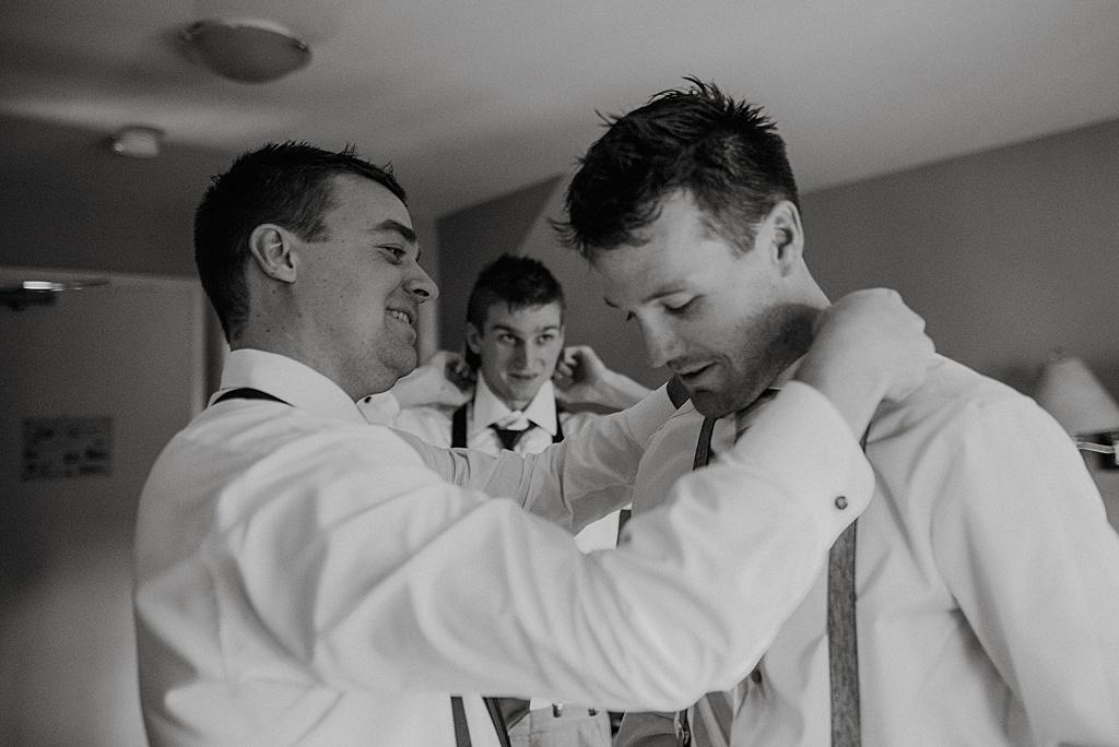 groomsmen-helping-groom-get-ready