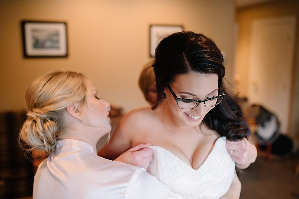 bride-getting-into-wedding-dress