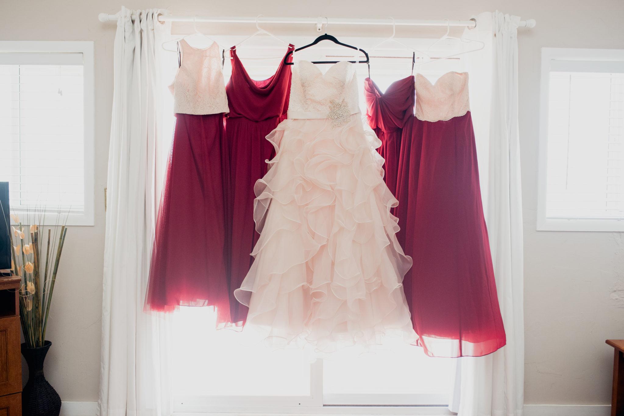 bridesmaids-dresses-hanging-in-window