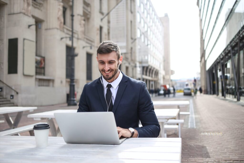 man-in-black-suit-jacket-using-macbook