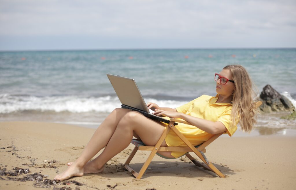 woman-in-yellow-shirt-sitting-on-brown-wooden-folding-chair