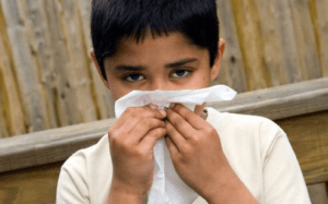 Child with runny nose in covid-19