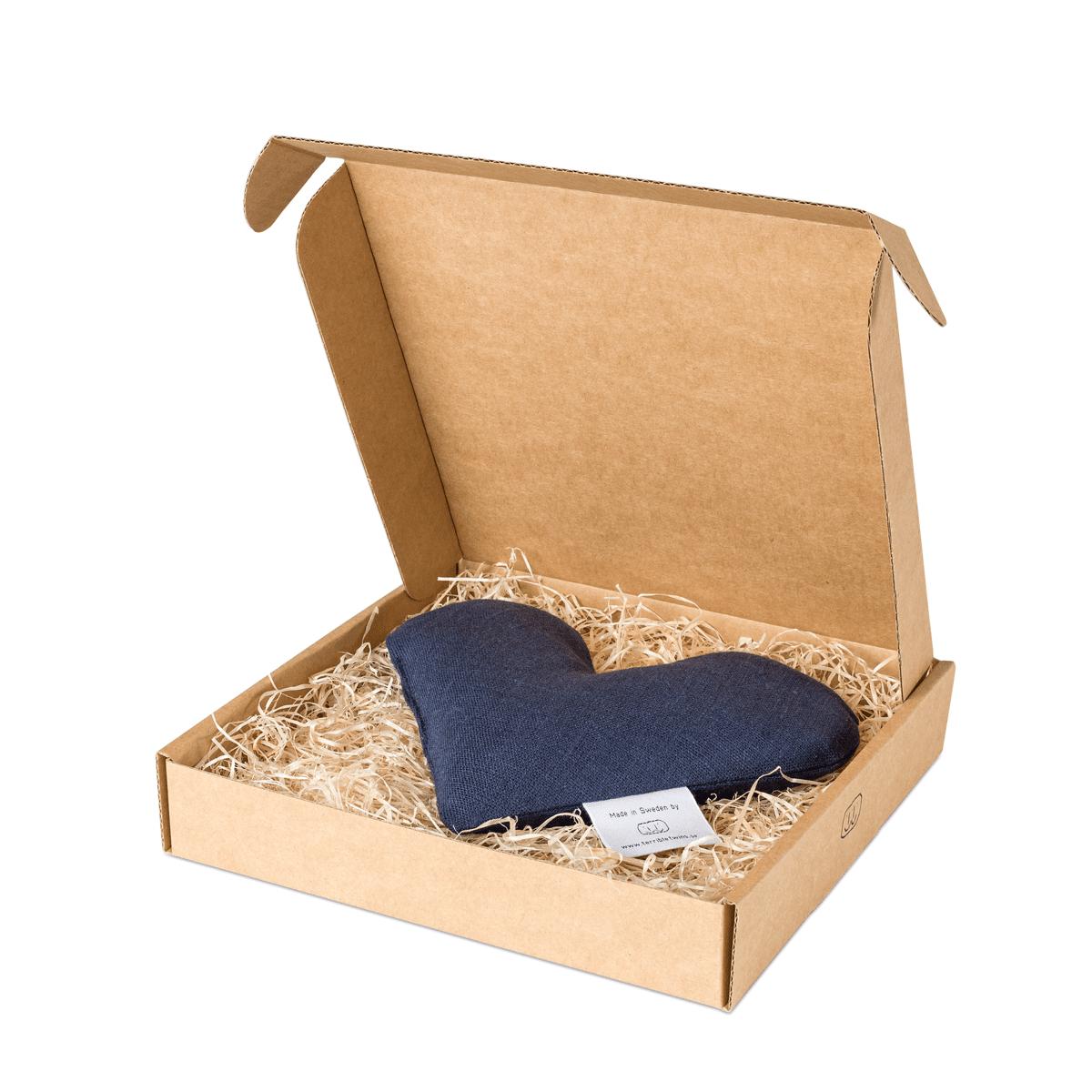 Marinblå sweetheart vetevärmare i förpackning