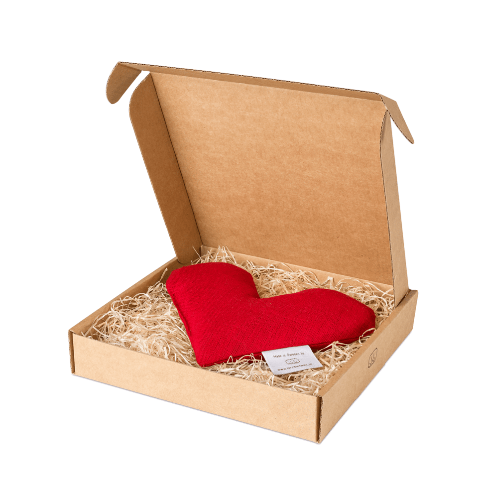 Röd sweetheart vetevärmare i förpackning