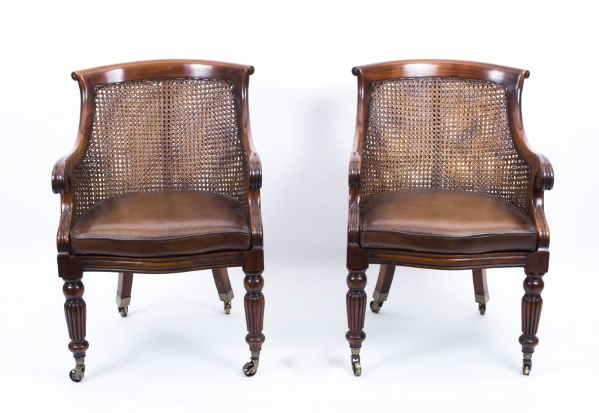 A Pair of Regency Style Caned Library Chairs or Bergere Armchairs