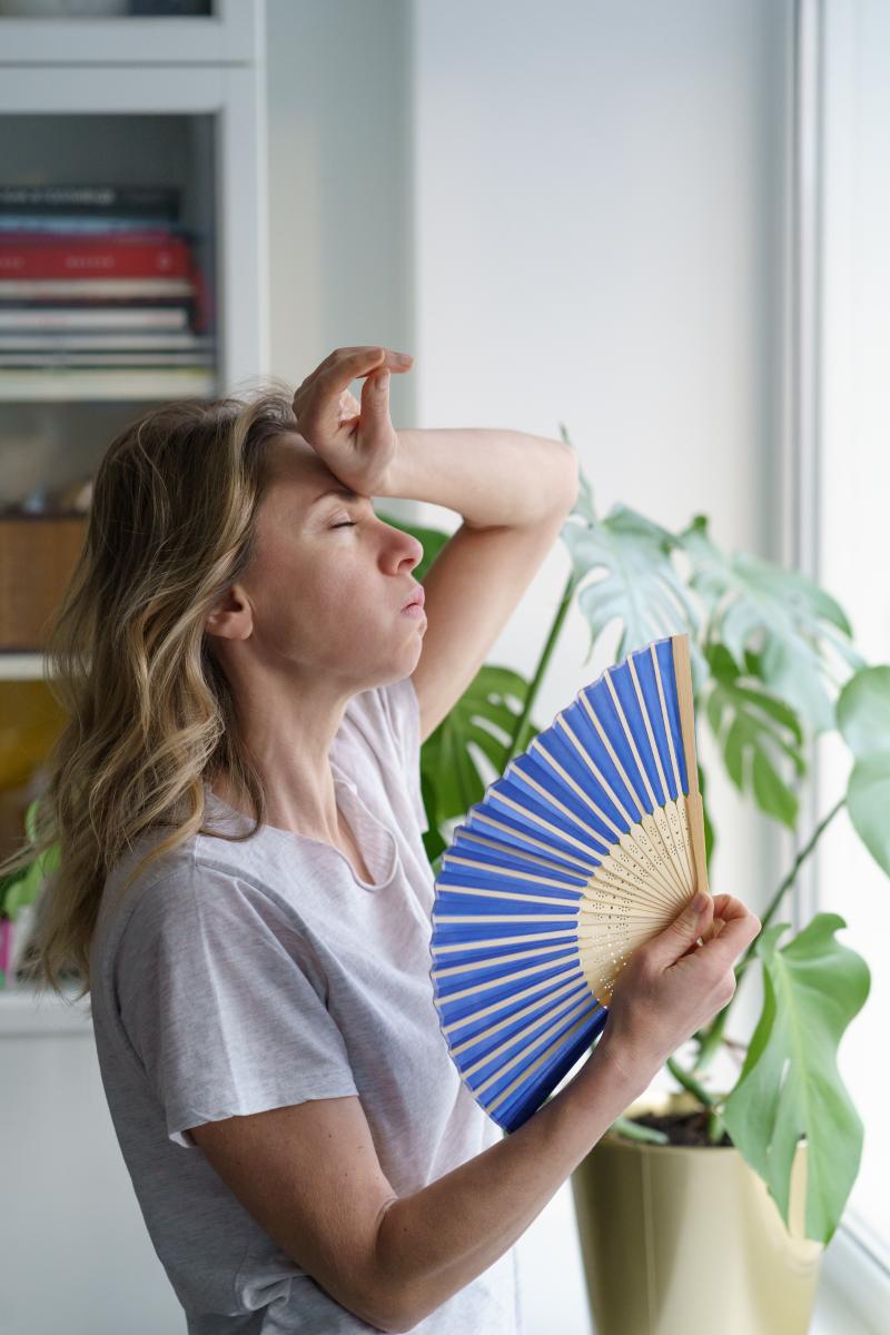 Woman in heatwave with fan