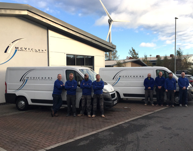 mcvickers-site-staff-with-vans