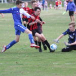 Ripon's goalkeeper gets to the ball just ahead of Matthew Hill