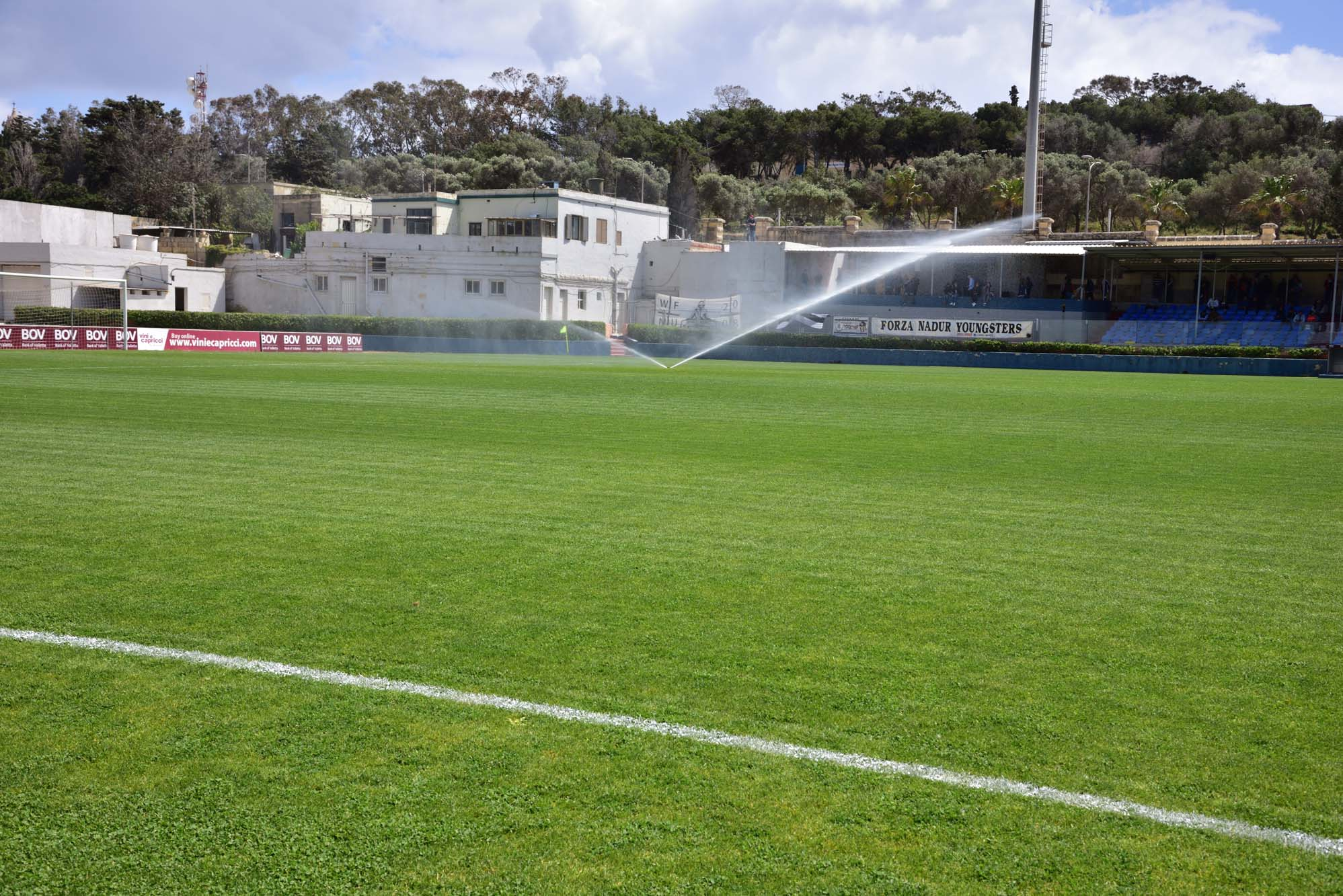 Gozo Football Stadium turf being watered
