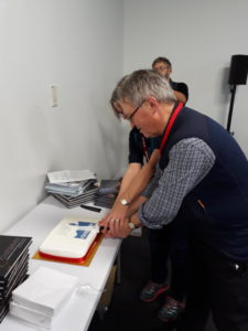 The owners of Cicerone Press cutting the cake