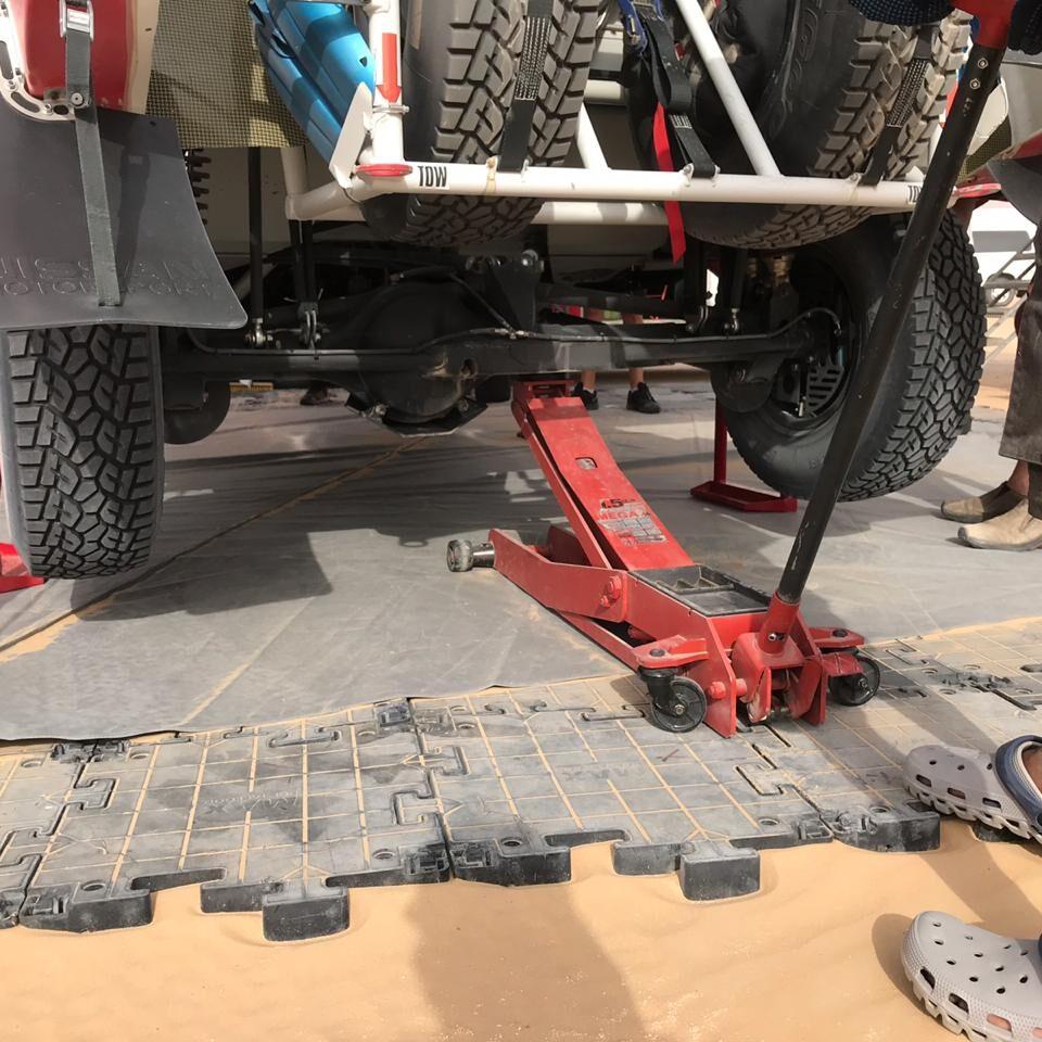Desert vehicle maintenance pad with jack Abu Dhabi UAE
