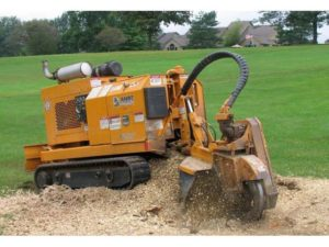 Stump removal with tracked grinder