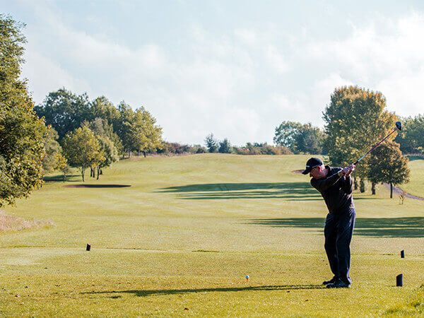 Golfer playing the course