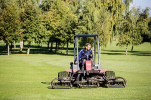 Green keeper mowing