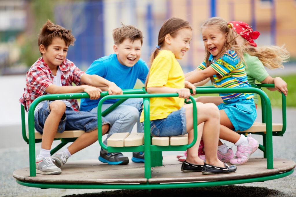 Image,Of,Joyful,Friends,Having,Fun,On,Carousel,Outdoors