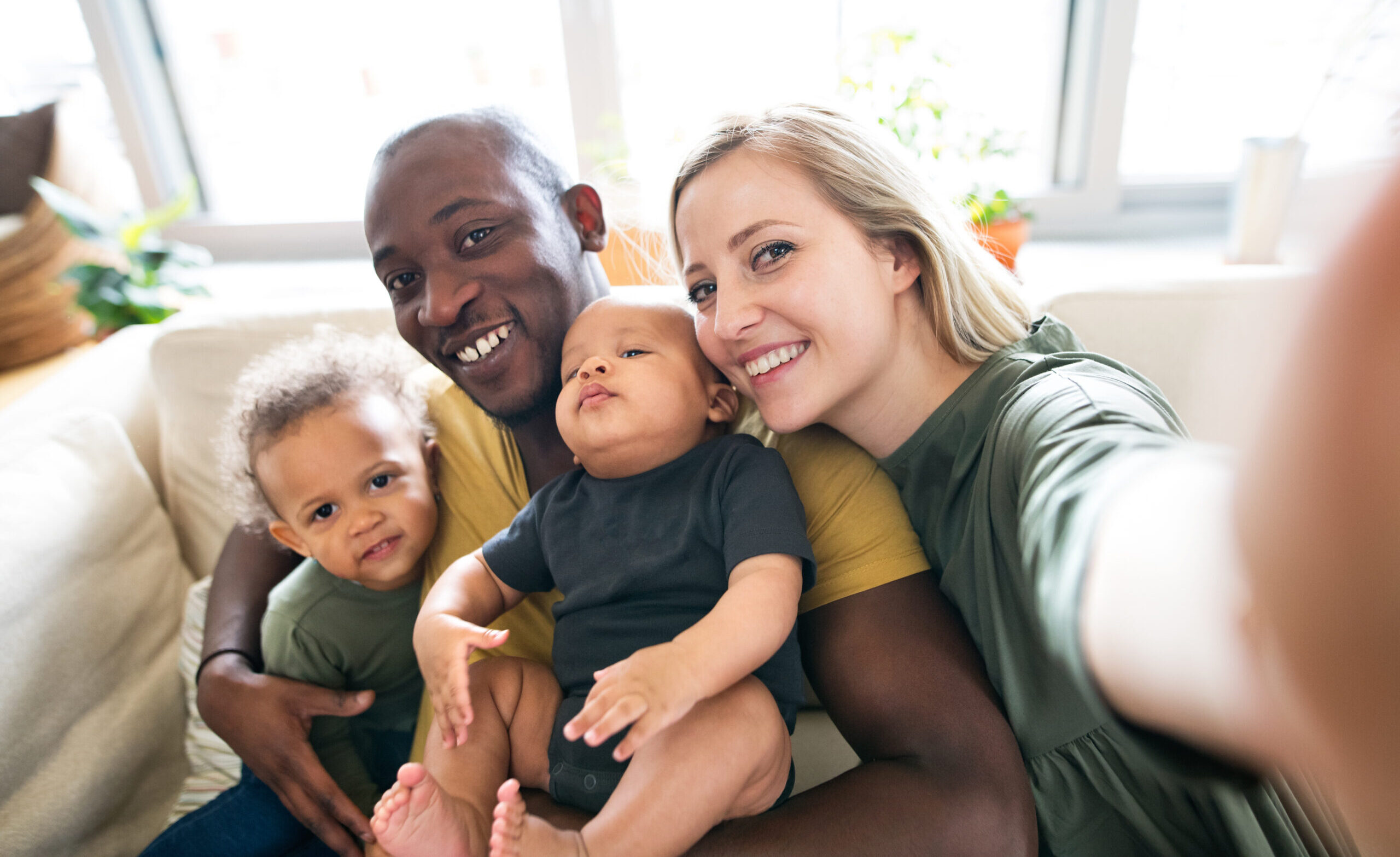 Young,Interracial,Family,With,Little,Children,Taking,Selfie.
