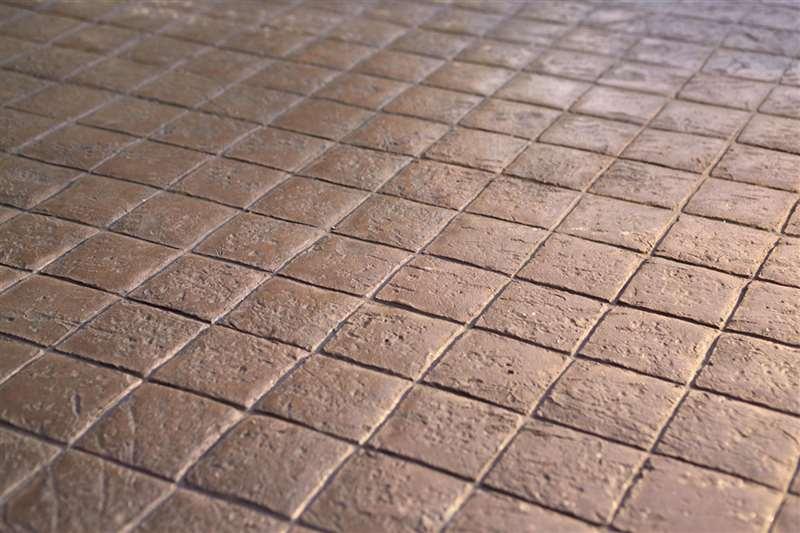 38 particolare marciapiede / cubetti di granito / colore bordeaux