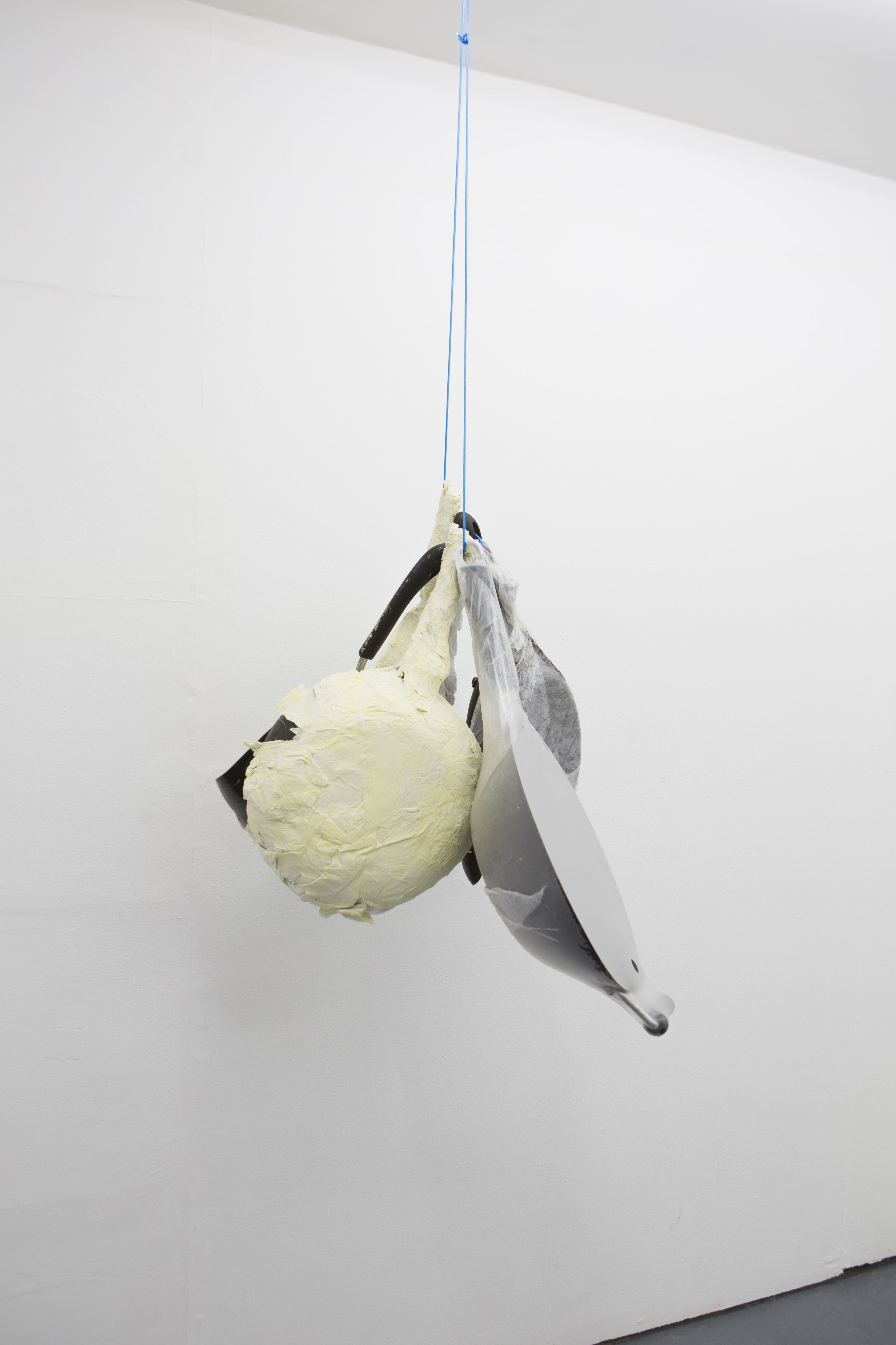 Thomas Greig Frying pans (2018); Dimensions variable; Frying pans, dust, plastic, tissue, acrylic paint, wire.