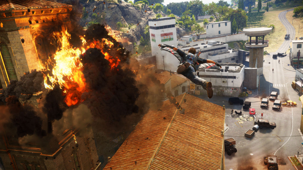 A JC3 liberation joined in progress: flying, explosions and troops amassing on the ground (note the masses of trucks on the left-hand side). The white building ahead is the police station, opening its gates allows the rebel army to come in and even up the odds.