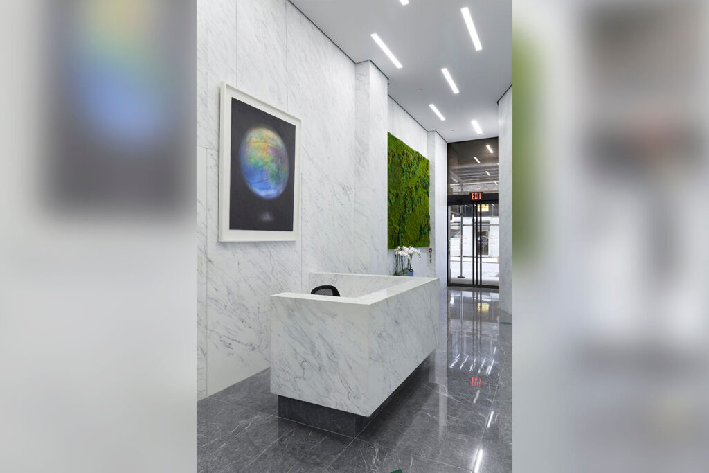 Lobby with white marble desk & walls