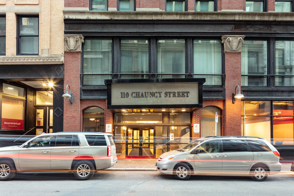 110 Chauncy Street building front entrance with large sign over the door with address