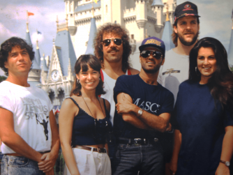 This is a picture of Garry Trainer at disney standing with George Michael and a few other members of his tour crew. Garry Trainer is standing to the far left and George Michael is centre right. Garry Trainer is an osteopath who has an amazing track record with famous clients treating them for back pain and vocal stress etc.