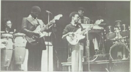 This is a picture of Angelo (left) on guitar, playing on stage with his brother Edwin Starr. A show he attended with his university campus friends.