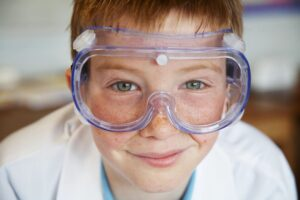 child with science goggles on