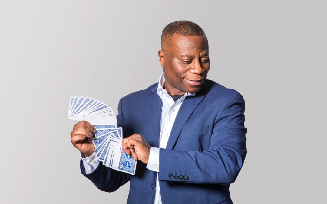Craig Martin performing magic with a deck of cards.