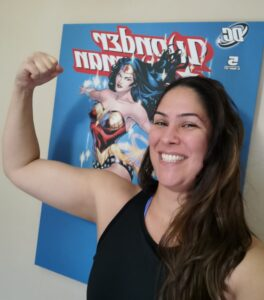 Ceza in front of Wonder Woman poster with biceps flexed