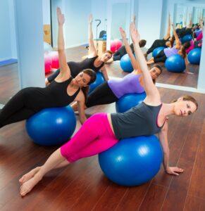 Women exercising on swiss ball