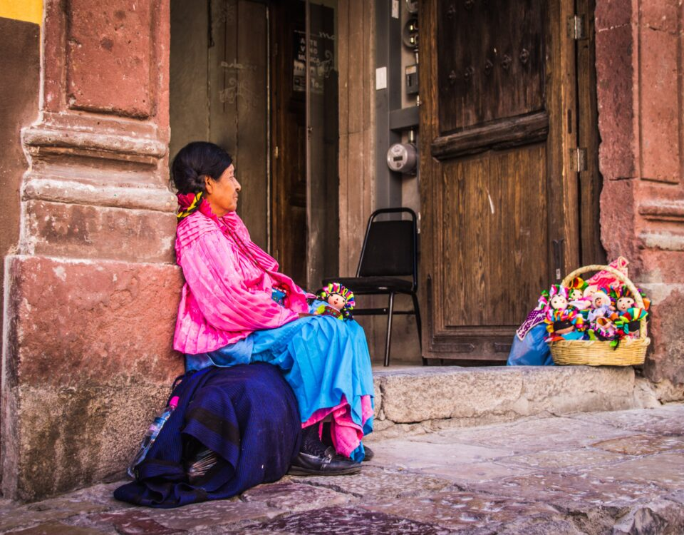 indigenous mexican woman selling dolls