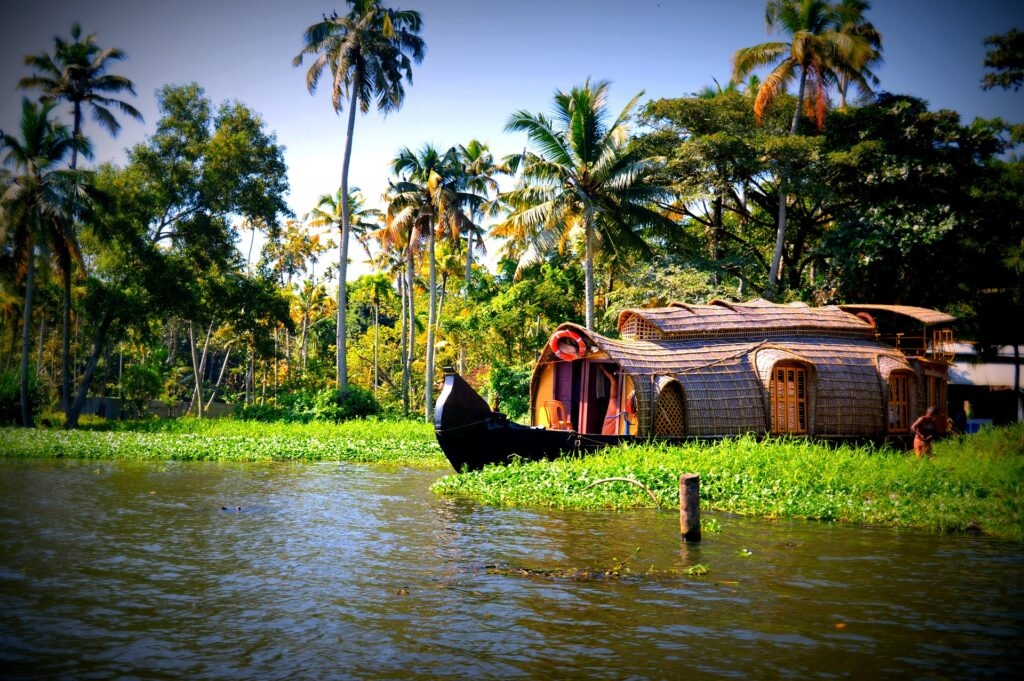 boat-parked-in-water-kerala-gods-own-country-destinations-in-india-entertainments-saga