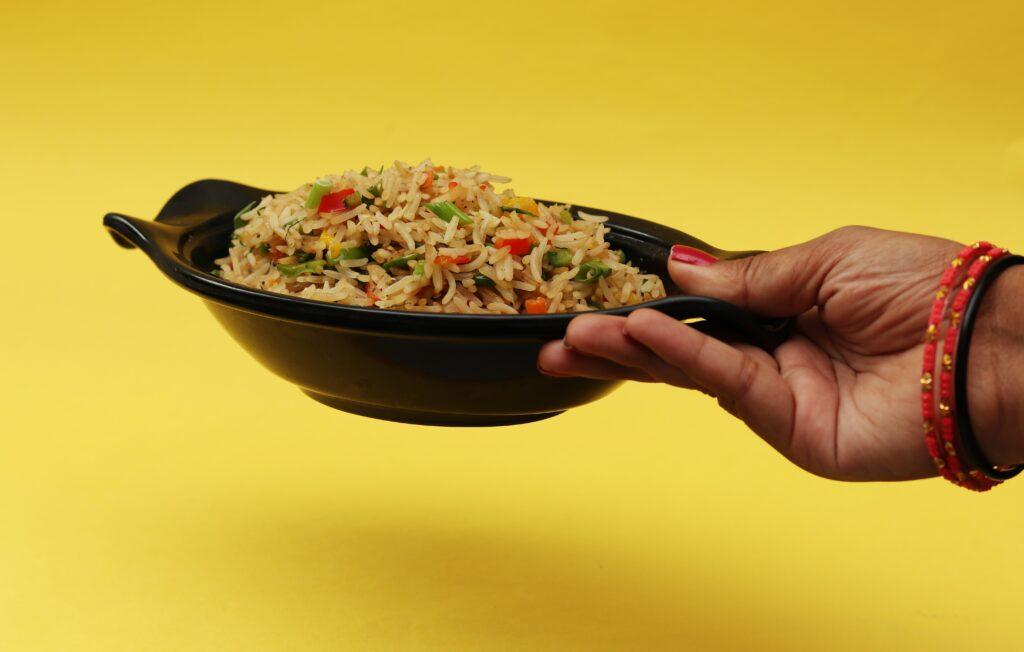 indian-woman-holding-bowl-of-rice-food-trends-2020-online-food-blog-entertertainments-saga