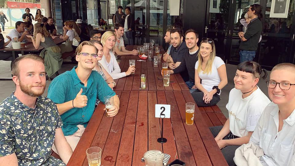 UC Environmental Science Society members enjoy social drinks at The Well