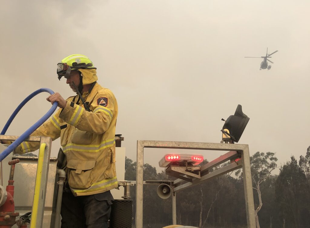 Firefighter and helicopter
