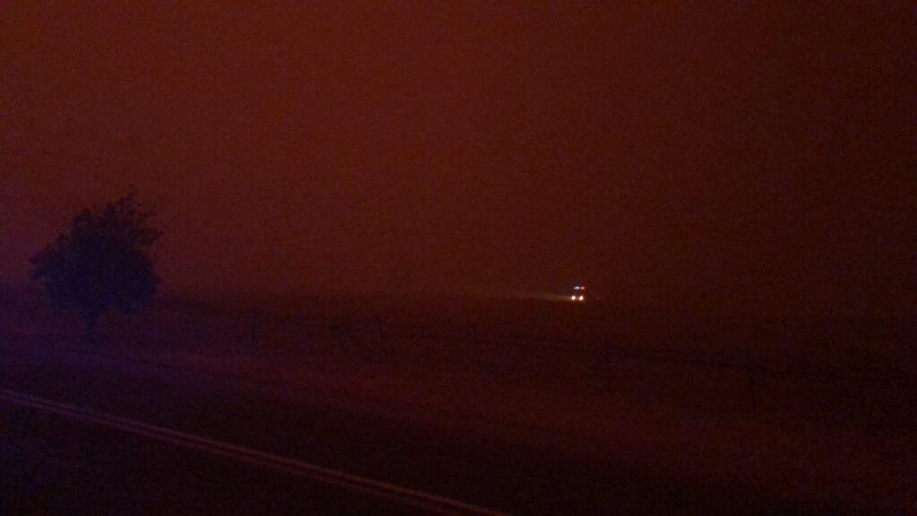 Fire truck driving through smoke