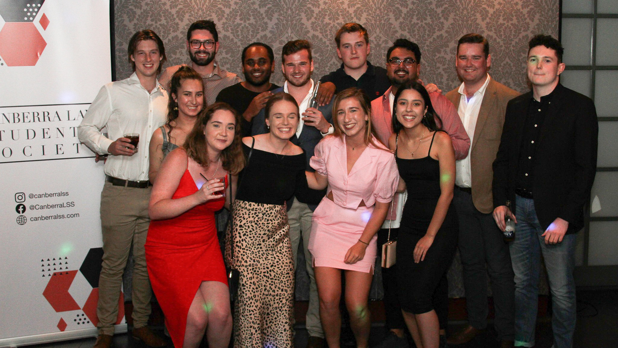 UC Economics Society members pose for group photo at social event