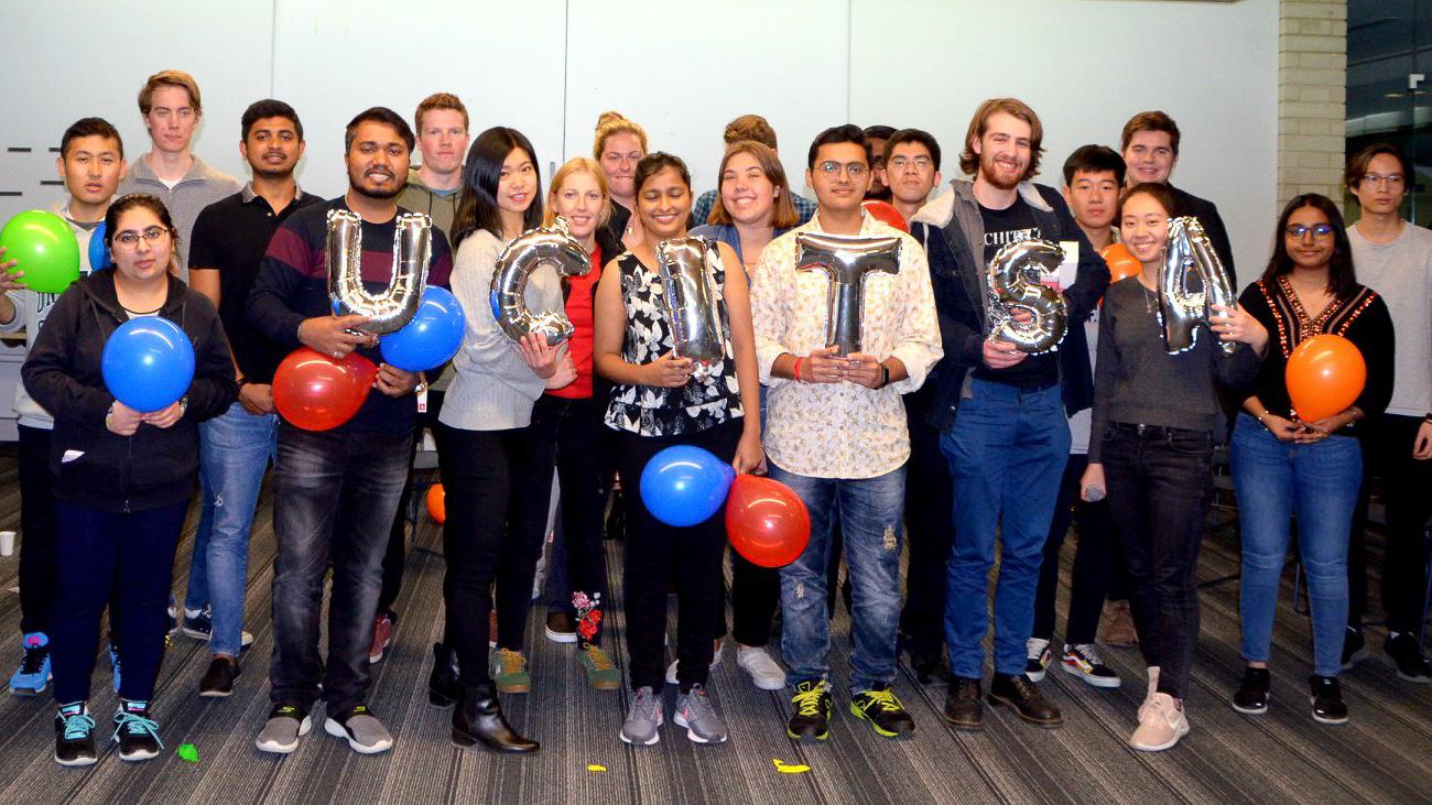 UCITSA members hold 'UCITSA' balloons at social events