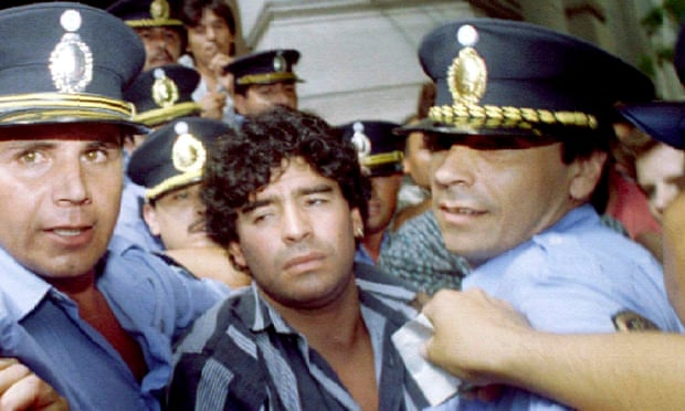 Maradona escorted by police after allegations he shot and injured journalists in 1994