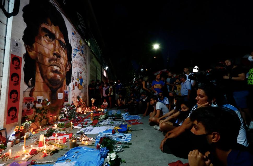 Hundreds gather at a Maradona memorial to mourn.